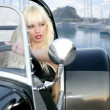 Blond beautiful black sport car young sexy girl - Stock Photo