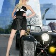 Blond beautiful black sport car young sexy girl — Stock Photo #5495786
