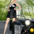 Blond beautiful black sport car young sexy girl — Stock Photo #5495788