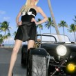 Blond beautiful black sport car young sexy girl — Stock Photo