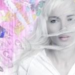 Blonde girl wind long hair butterflies pink — Stock Photo