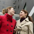 Two happy young women in winter — Photo