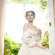 Victorian beautiful woman, white dress at home — Stock Photo