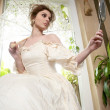 Victorian beautiful woman, white dress at home - Stock Photo