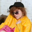 Eighties fashion metaphor woman yellow jacket - Stock Photo