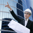 Architect woman working outdoor with buildings — Stock Photo