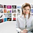 Business redhead beautiful woman headphones tech helpdesk - Stock Photo