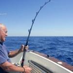 Angler senior big game sport fishing boat — Stock Photo