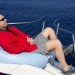 Man on bow boat relaxed on bean bag — Stock Photo