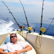 Royalty-Free Stock Photo: Sailor man fishing resting in boat summer vacation