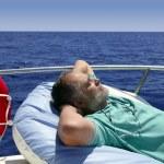 Sailor senior man having a rest on summer boat — Stock Photo