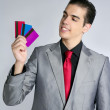 Businessman young with three credit cards — Stock Photo