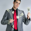 Businessman with dollar notes suit and tie — Stock Photo