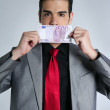 Formal young businessman portrait with 500 euro note — Stock Photo