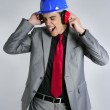 Businessman with blue hardhat and safety headphones — Stock Photo #5496728