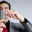 Businessman taking photos with phone camera — Stockfoto