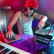 Dj with colorful light and music mixing equipment — Stock Photo #5496800