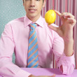 Funny businessman with lemon fruit on hand — Stock Photo #5496856