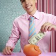 Businessman with piggy bank dollar note - Stock Photo