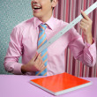 Funny young businessman with measuring ruler - Stok fotoğraf
