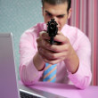 Businessman point his handgun to camera - Stockfoto