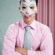 Businessman with funny rabbit mask — Stock Photo