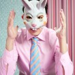 Businessman with funny rabbit mask — Stock Photo #5496892