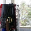 Rack of clothes with fashion accesories, belts — Stock Photo #5496912