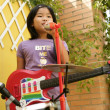 Live concert at home little girl playing — Stock Photo