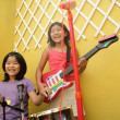 Live concert at home two little girls playing — Stock Photo #5496971