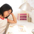 Asian little girl studying at home — Stock Photo