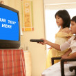 Stock Photo: Asian girls as princess, tv remote control