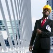 Stock Photo: African american architect engineer yellow hardhat