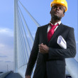 African american architect engineer yellow hardhat — Stock Photo #5497301