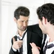 Handsome man humor funny gesture in a mirror — Stock Photo