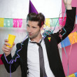Happy party young man drinking enjoying alone — Stock Photo