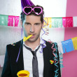 Blowing noisemaker suit party funny young man — Stock Photo