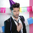 Flirty young party man seductive gesture - Stock Photo