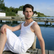 Mediterranean young man relaxed on wood pier — Stock Photo #5497606