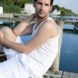 Mediterranean young man relaxed on wood pier — Stock Photo #5497610