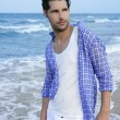 Mediterranean latin young man on beach — Stock Photo