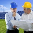 Two engineer architect plan hardhat solar plates - Stock Photo