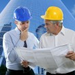 Engineer architect two expertise team plan hardhat - Stock Photo