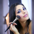 Indian fashion model makeup with brush — Stock Photo