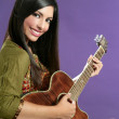 Beautiful brunette playing acoustic guitar — Stock Photo #5498248