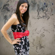 Beautiful brunette urban woman on city graffiti — Stock Photo #5498279