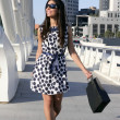 Beautiful brunette shopaholic outdoor city — Stock Photo