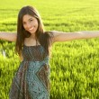 Stock Photo: Beautiful brunette indian woman in green rice fields