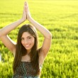 Beautiful brunette indian woman in green rice fields - Foto Stock