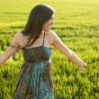 Beautiful brunette indian woman in green rice fields — Stock fotografie